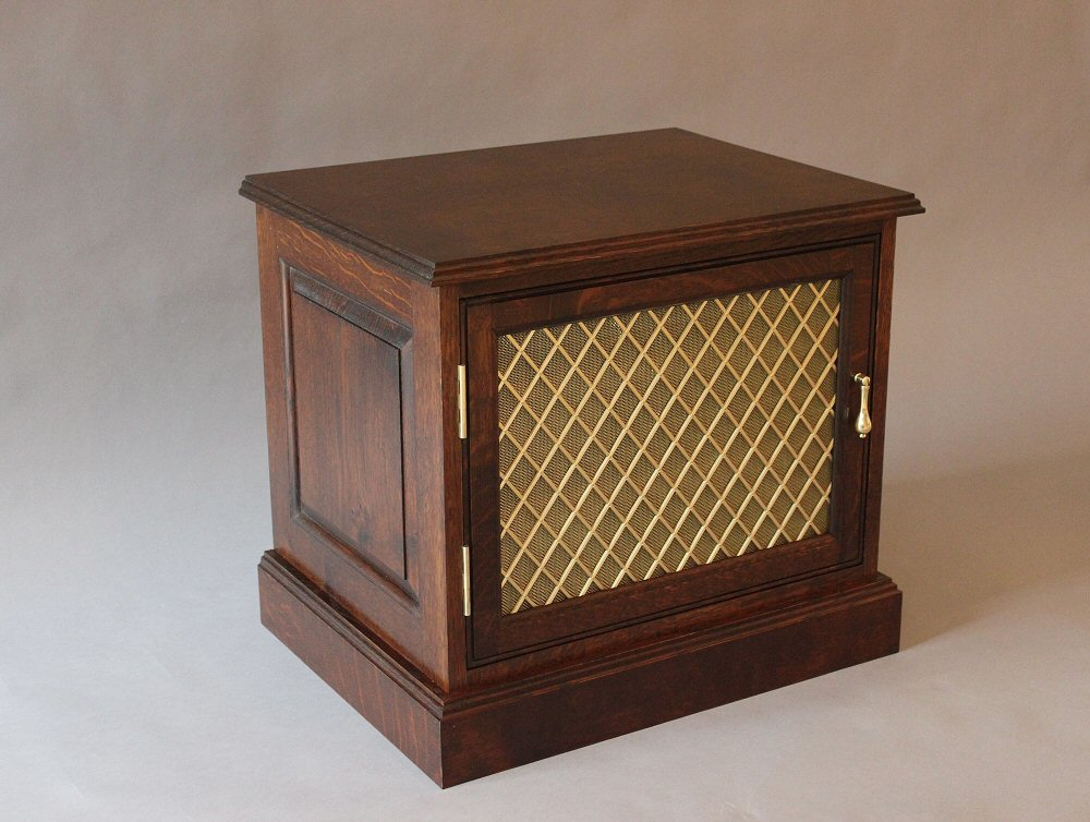 A small oak TV cabinet designed to hide the Sky Box DVD player etc. The brass grille in the door allows the infrared remote control signal through ... & Christine Layton handmade furniture